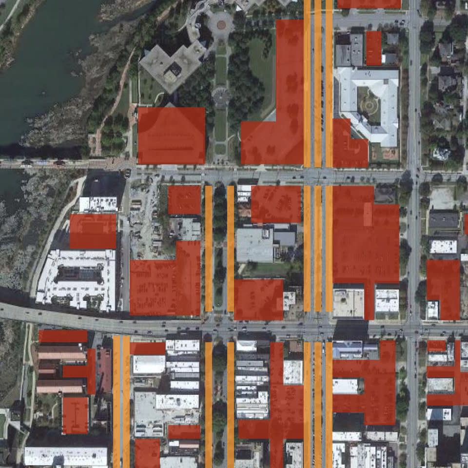 A satellite map of the Columbus, GA downtown with parking spots highlighted.