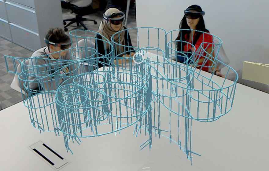 Aecom employees review the fabrication model of the Barkow Leibinger Summer House