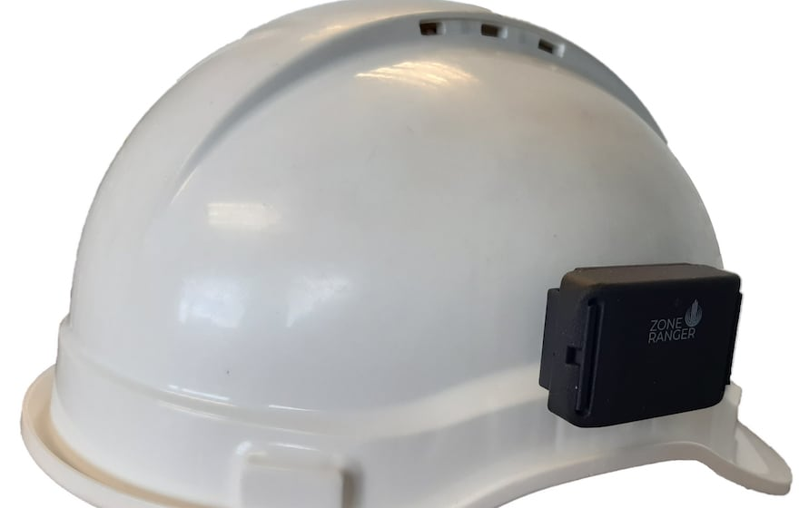 Image: a hard hat with OnSite Support's ZoneRanger attached