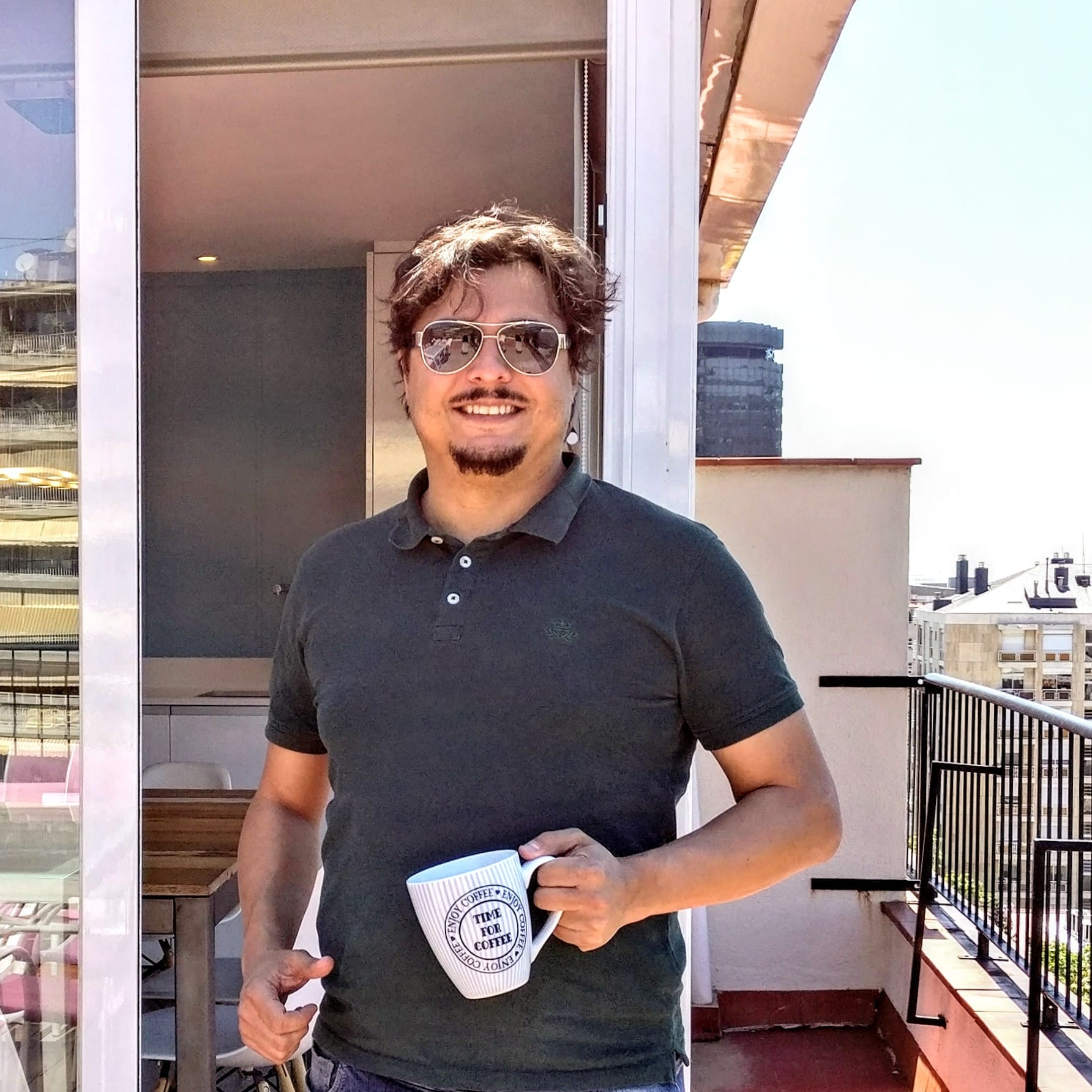 The picture of Jaume taken on the terrace of the Ferran Batik apartment in 2019. Stay in an apartment when you next travel to Barcelona.