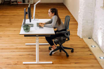 What helps to relieve back pain caused by sitting down for a long time?