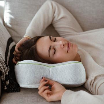 Woman relaxing on blackroll pillow