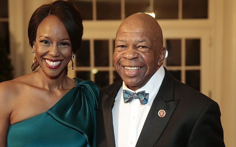 Representative Elijah Cummings, a Democrat from Maryland, right, and Maya Rockeymoore Cummings arrive to a state dinner hosted by U.S. President Barack Obama and U.S. first lady Michelle Obama.