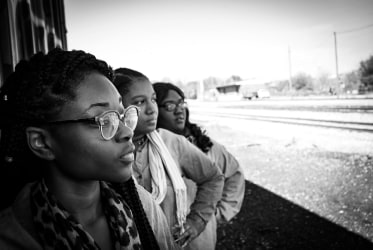 Black women staring into the distance
