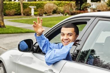 Black guy driving away saying bye.