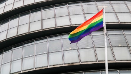 LGBTQ Pride Flag Outside An Office Building