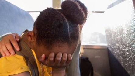 Black girl on school bus