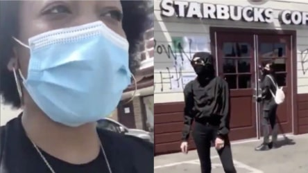 Two women are confronted by Black protesters who ask them to stop tagging.