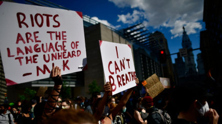 """Protesters hold signs stating """"I CAN'T BREATHE"""" during a march through Center City on June 1, 2020 in Philadelphia, Pennsylvania."""