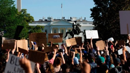 Demonstrators hold up placards protest outside of the White House, over the death of George Floyd in Washington D.C. on June 1, 2020.