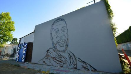 Street art in honor of George Floyd is seen on Melrose Avenue on June 21, 2020 in Los Angeles, California.
