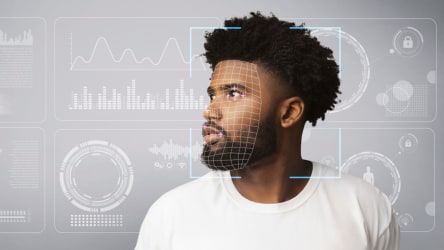 Personal data collection. Scan of African American male against virtual screen with diagrams.