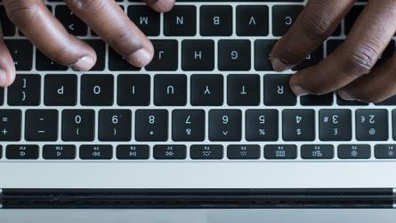 Black hands typing
