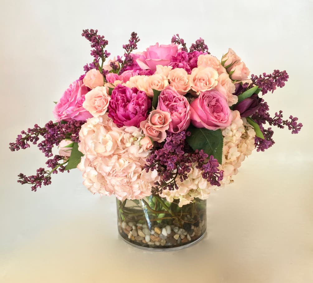 436128fd6 Pink Roses and Peonies on a bed of Hydrangeas in a rounded