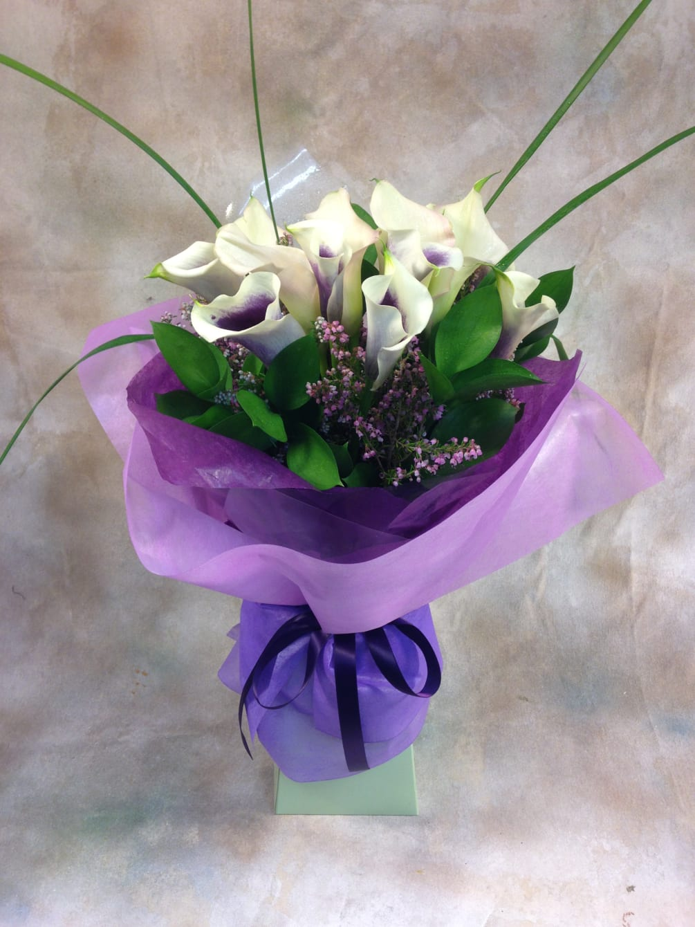 b38c99583645 A lush European hand-tied bouquet of Picasso (white with purple blush)  miniature