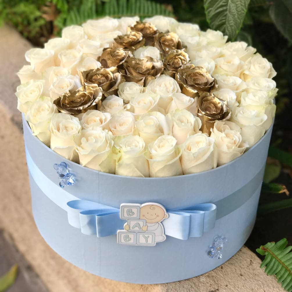 Congratulate the little one with this precious baby blue flower box filled