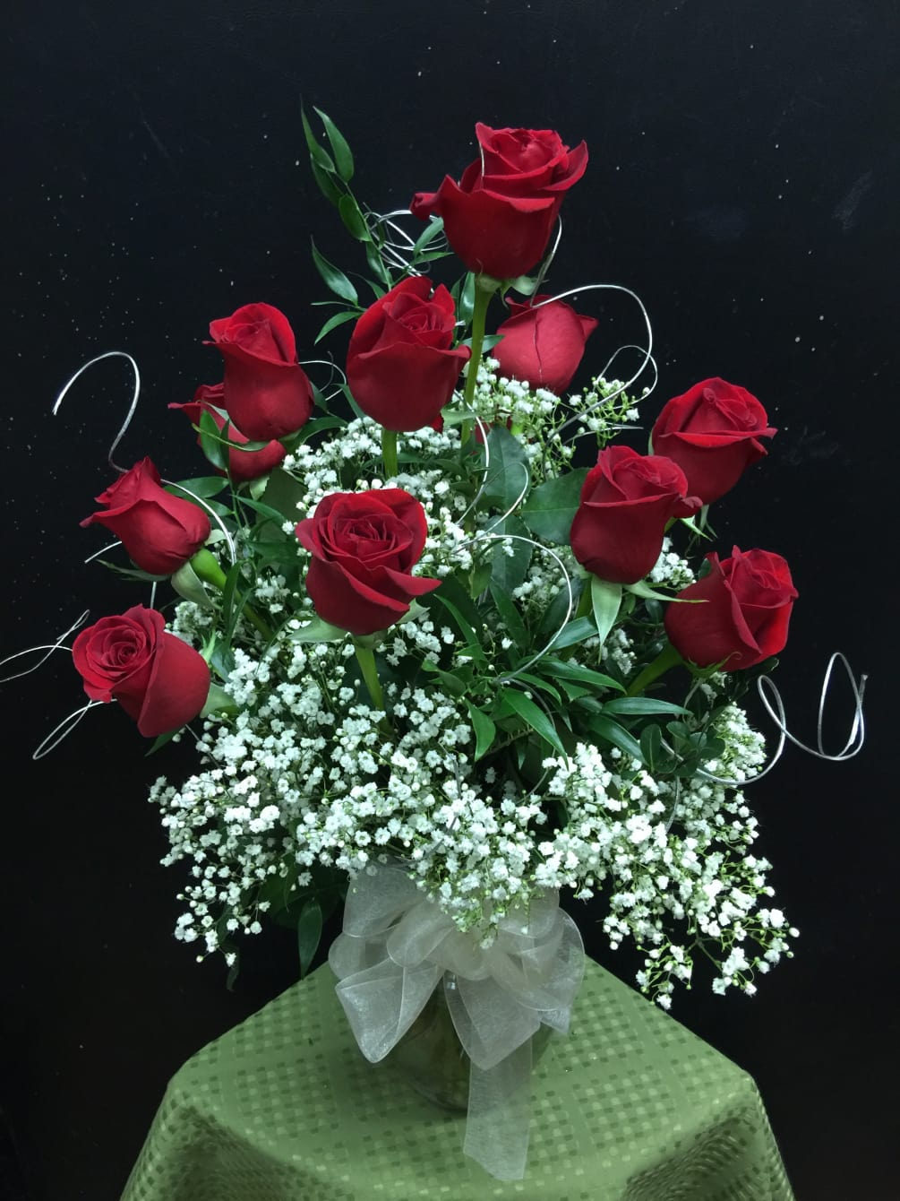 Dozen Long Stem Red Roses Arranged In A Vase With Babys Breath And