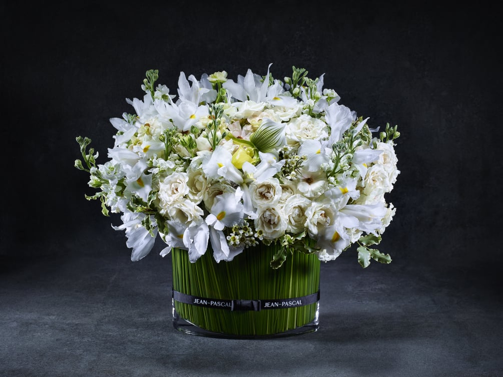 This impressionable and enchanting bouquet is bursting with fanciful White Wax flowers