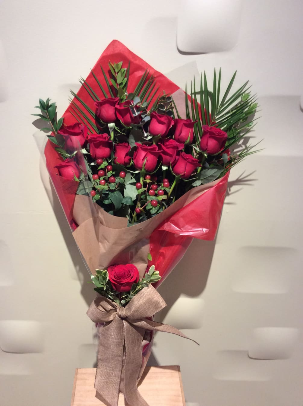 Dozen Red Roses Wrap Bouquet By Downtown Flowers