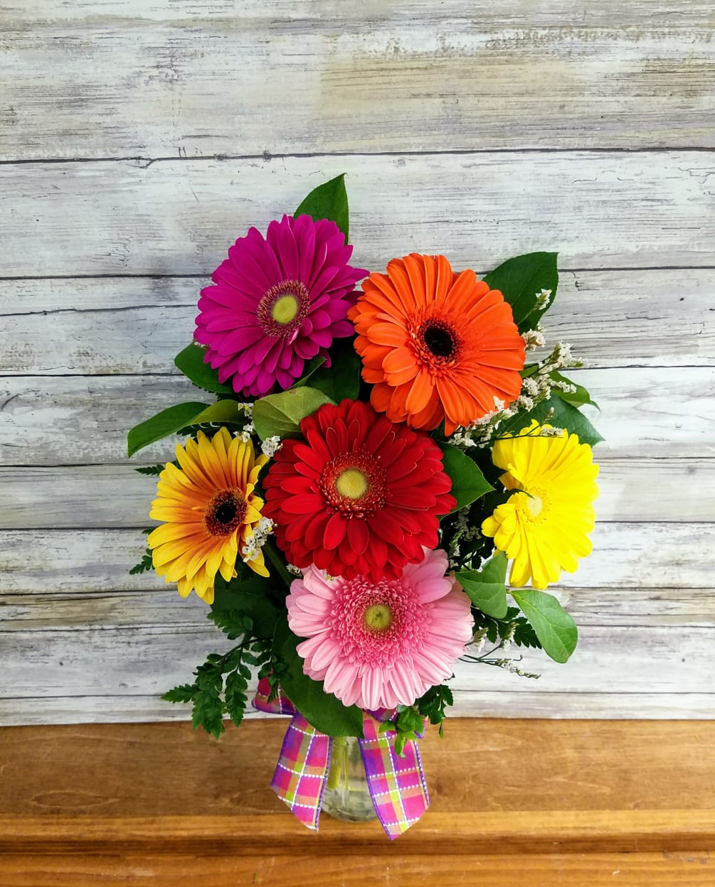 Gerbera Daisy Mason Jar. Brighten their day with this vibrant bouquet! Send someone 6 beautiful bright
