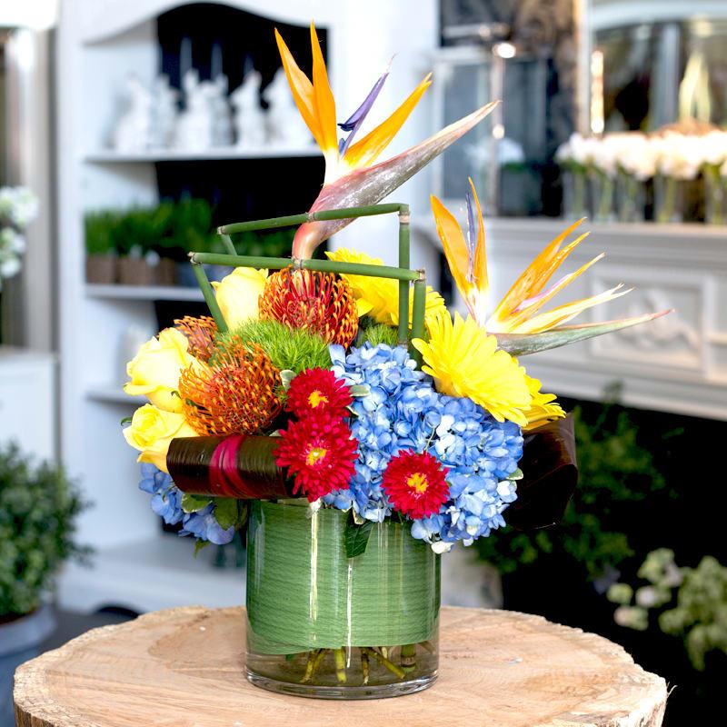 2e8d2c3080d A tropical mixed arrangement to include Birds of Paradise, Pin cushion  Protea