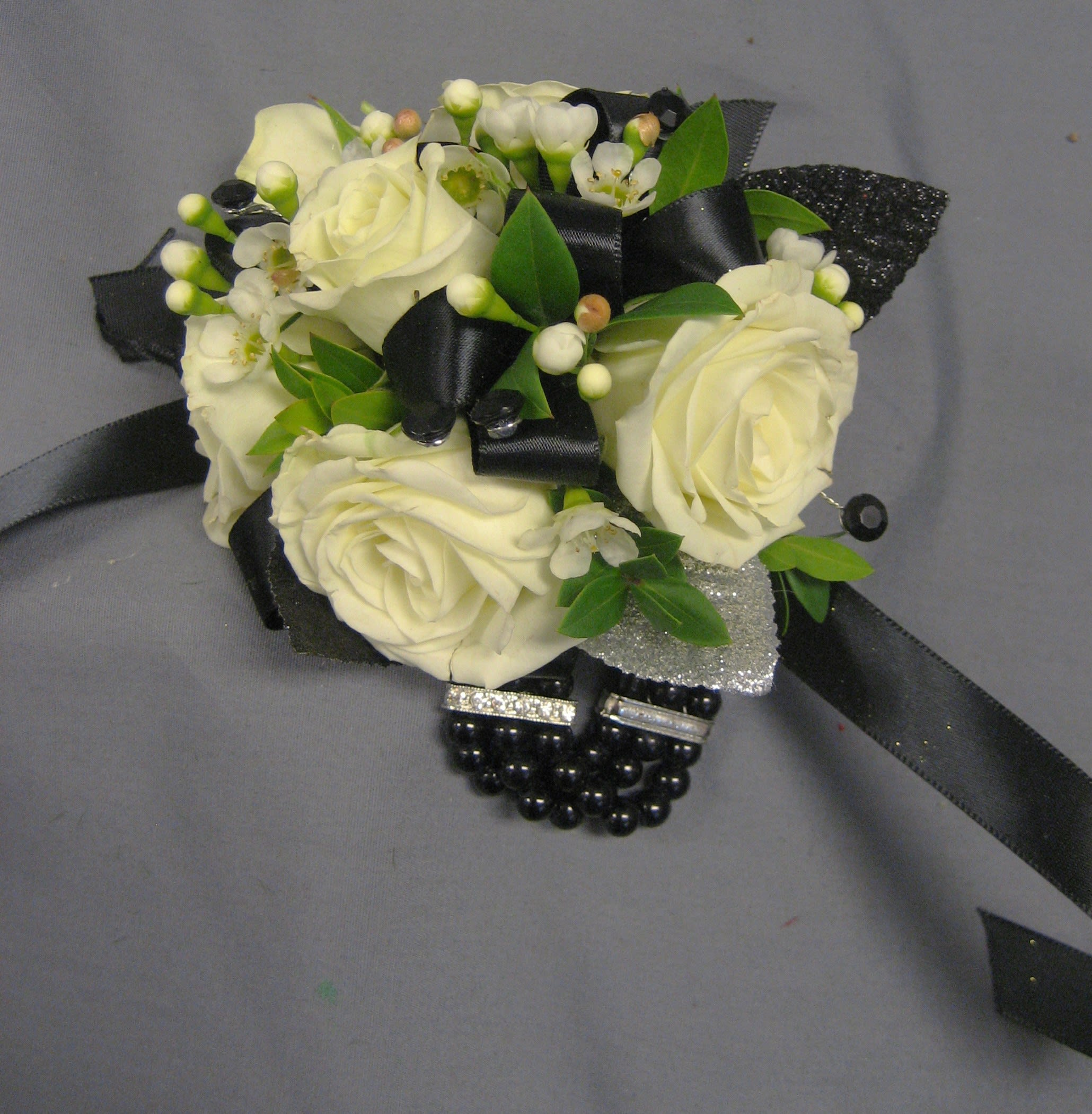 White rose black pearl wristlet w27 in north wales pa the rhoads garden