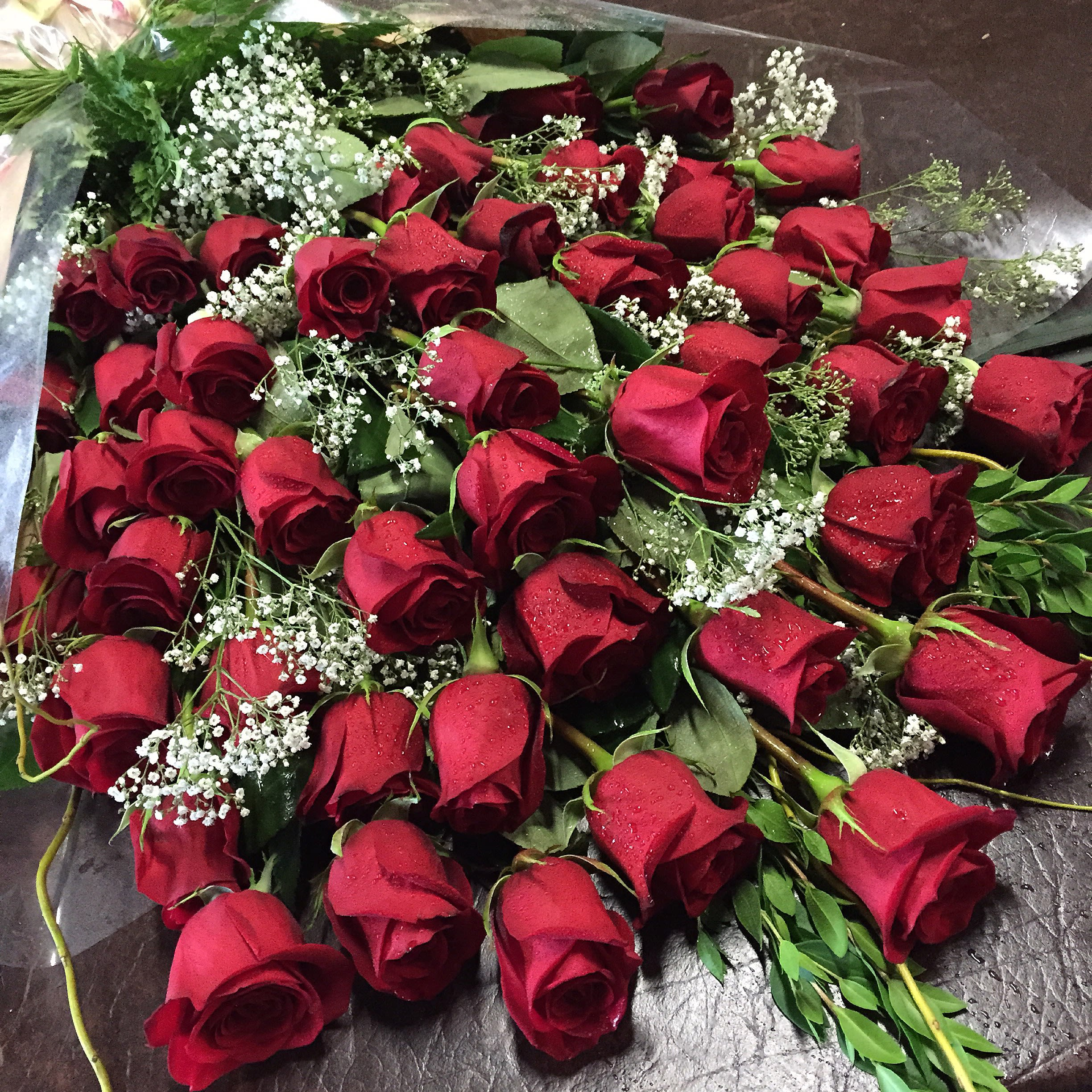 4 Dozen Wrapped Roses In Los Angeles Ca Westwood Flower Shop