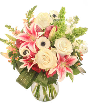 Stargazer lilies, snapdragons, white anemone, roses, and bells of Ireland