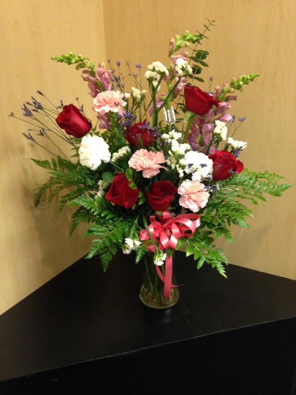 Roses, Carnations, Snapdragons, mixed greenery and filler