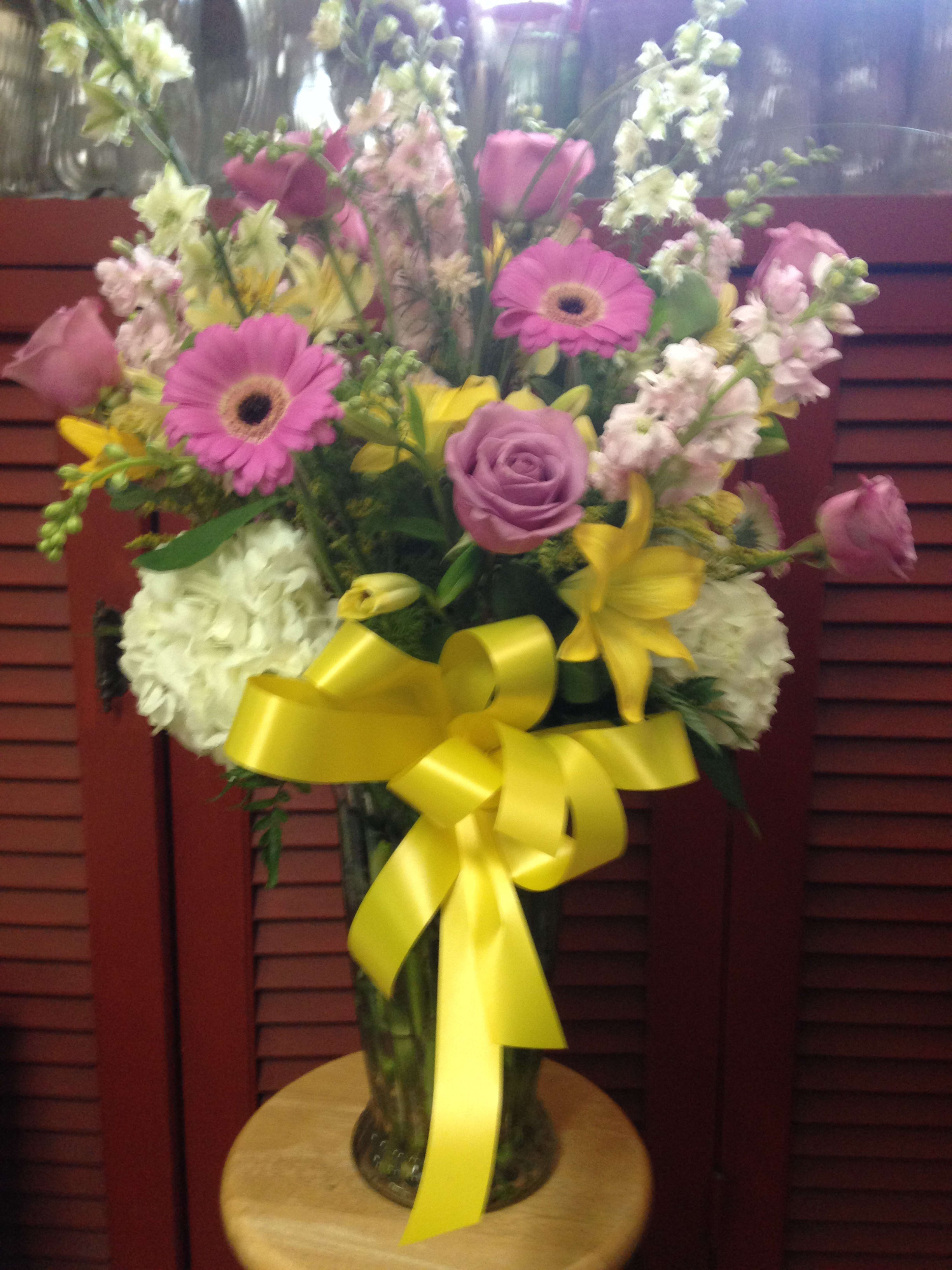 Snap dragon, roses, gerbera daisies, and other mixed flowers