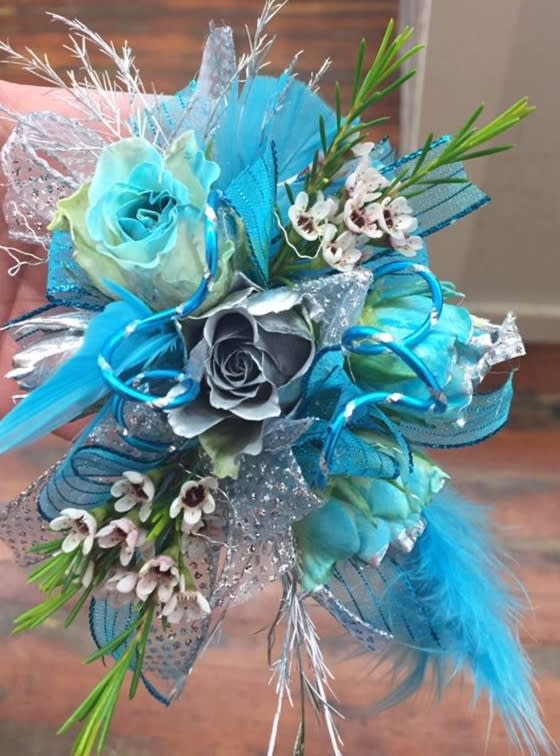 Bright Turquoise And Silver Wrist Corsage In Centerville Ia
