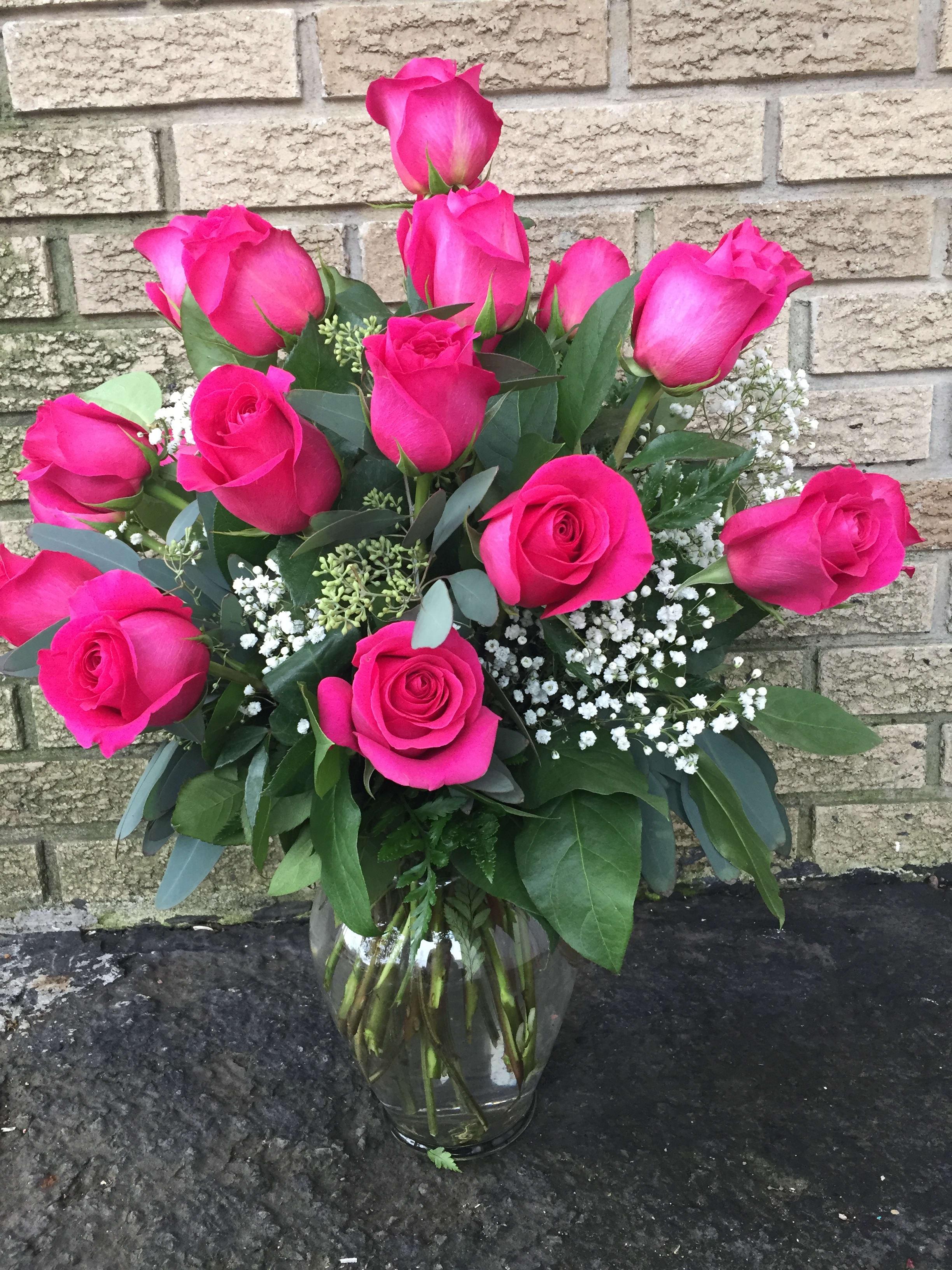 Dozen Hot Pink Roses By Landmark Florist