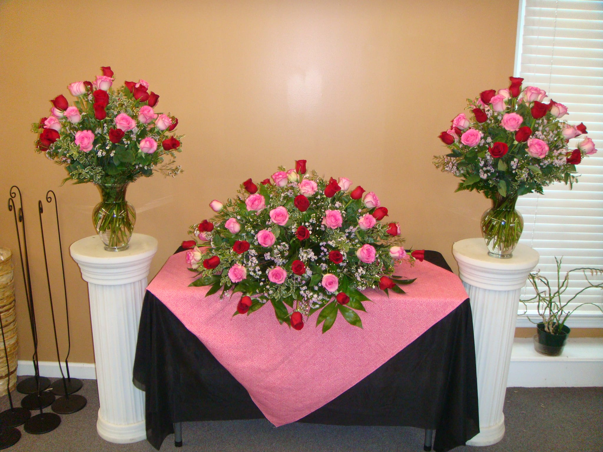Loving tribute casket cover red pink roses