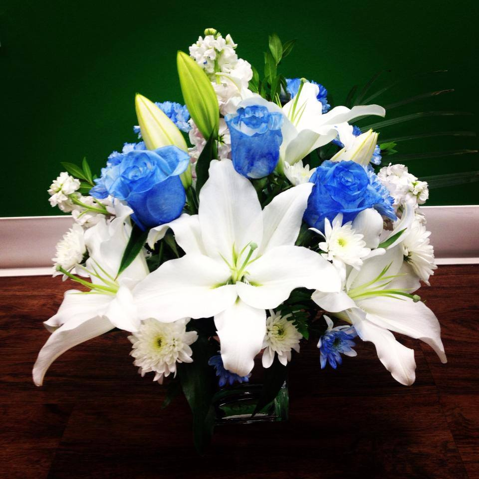 Blue Roses And White Lily By Garden Of Roses