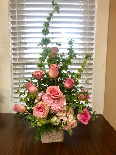 All Spruced Up - A floral arrangement for your home will really spruce things up.