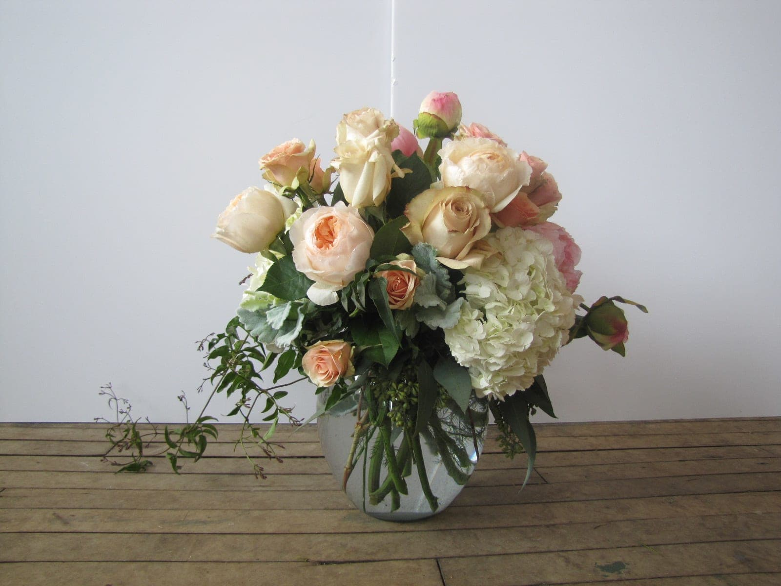 Abundance - The best.  A GORGEOUS mix of garden roses, peonies and hydrangea.  Nestled in premium foliage with trailing jasmine.  Romantic and beautiful.  Staff favorite!