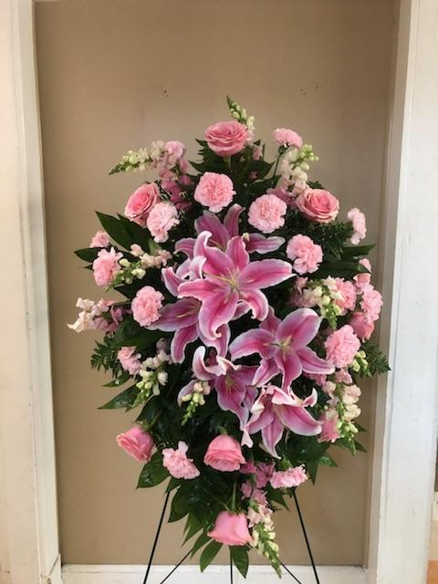 Pretty in Pink Sympathy Spray - This feminine standing spray is a pink garden of flowers