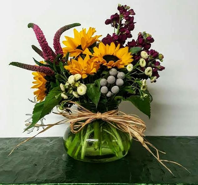 A brilliantly colored bouquet filled with spring flowers that will fill the