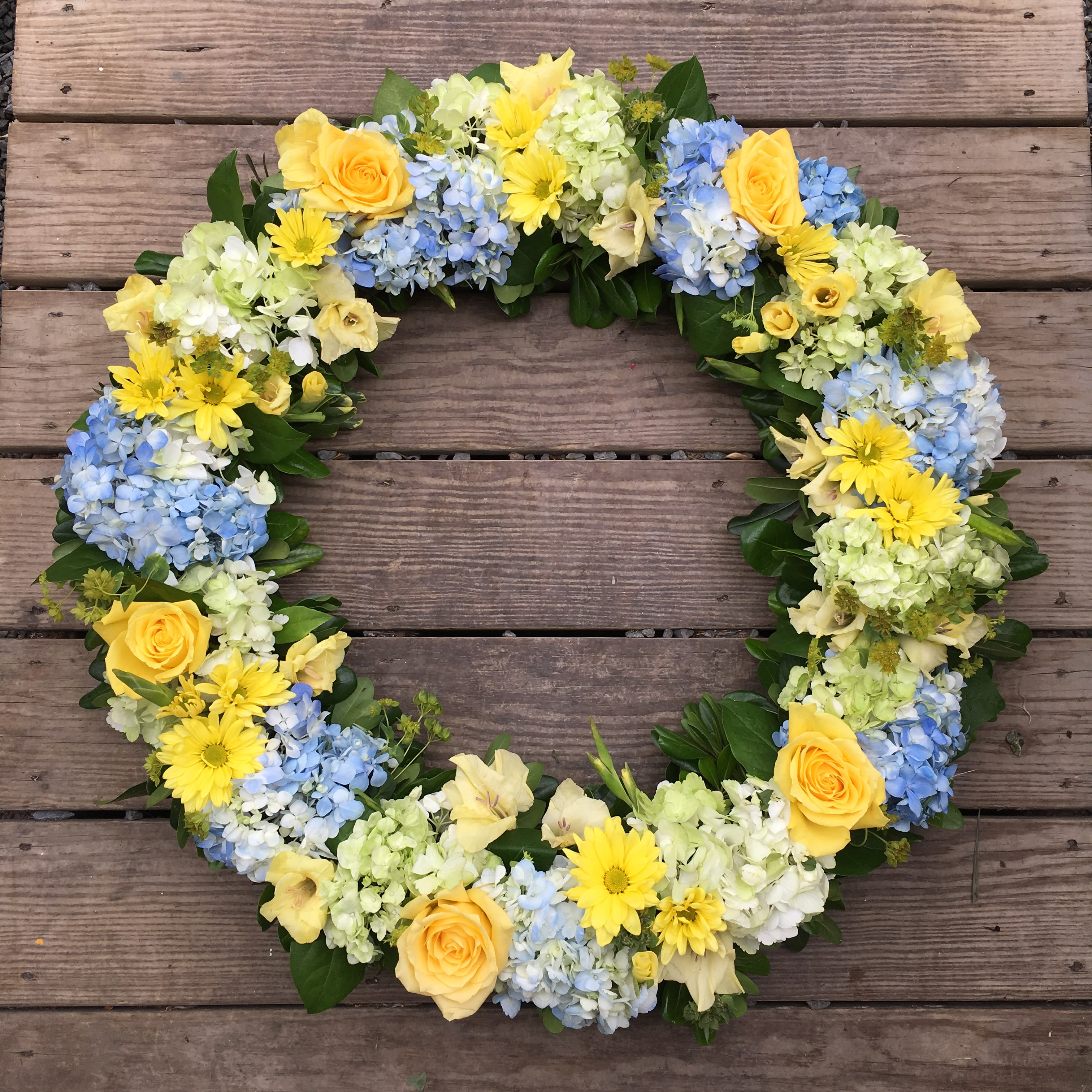 Evans Blue Yellow Green & White Funeral Wreath in Peabody ...