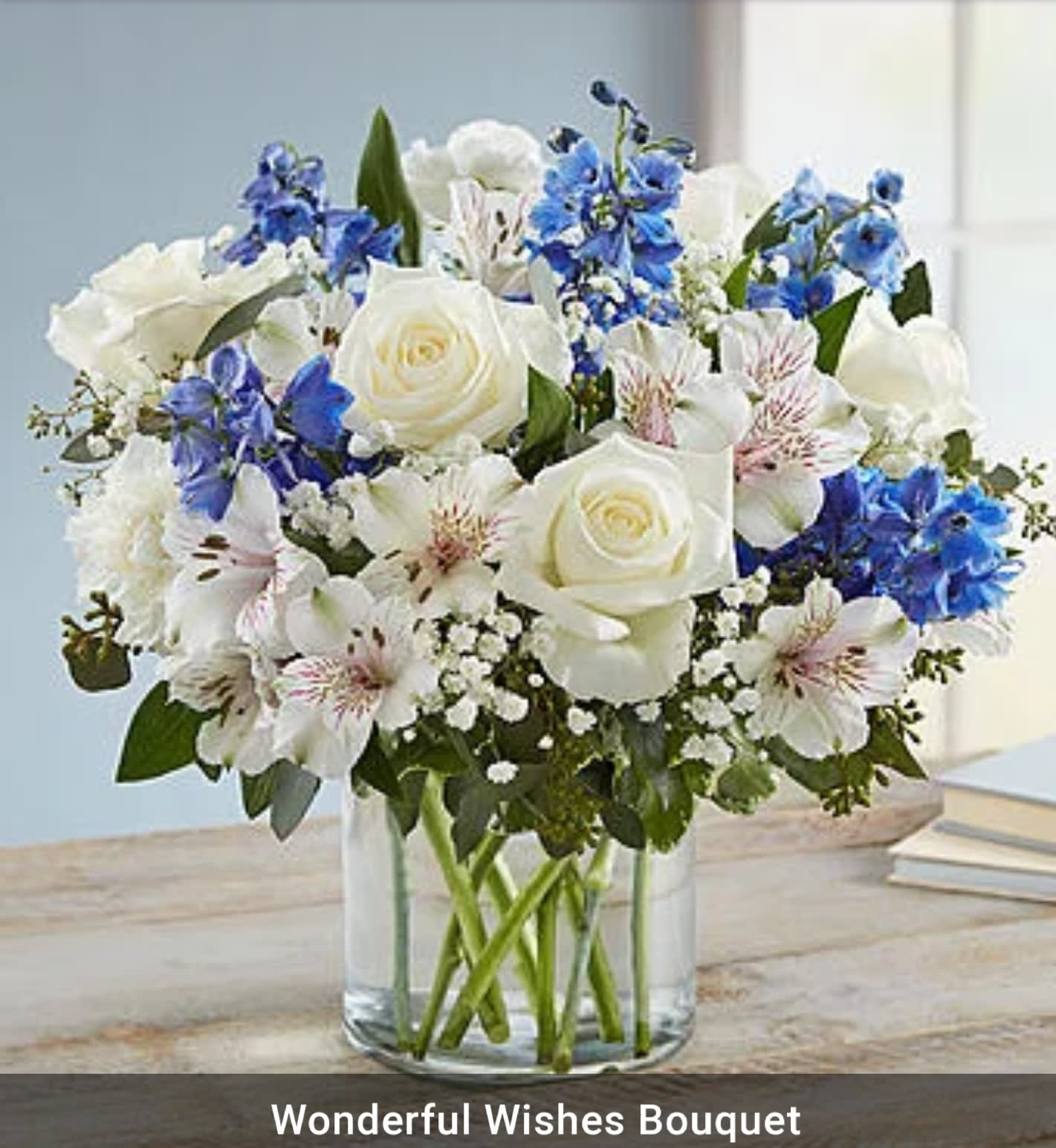 Wonderful Wishes Bouquet Mixture Of White Flowers With A Blue Flower Accent In Clear