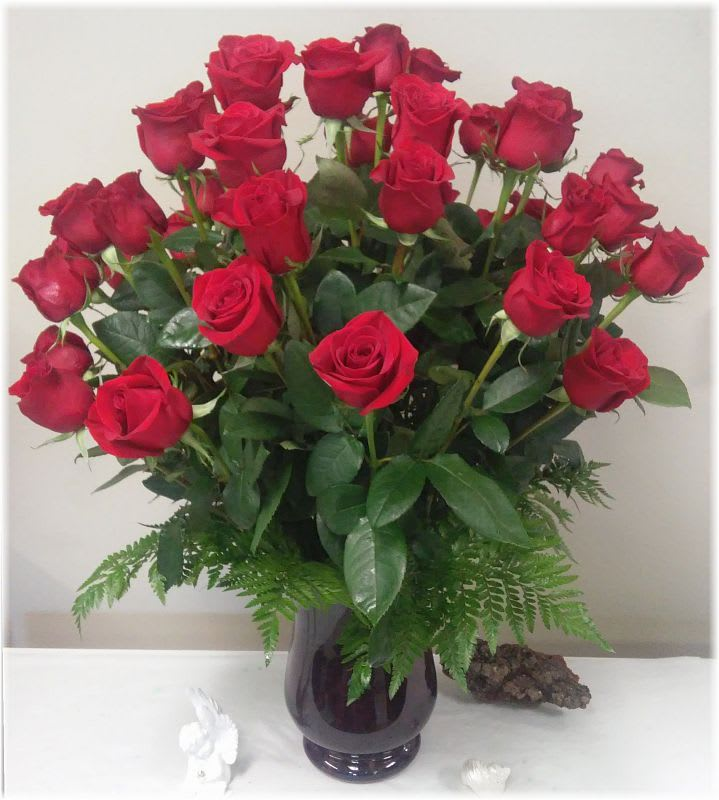Four Dozen Roses By Weathers Flower Market