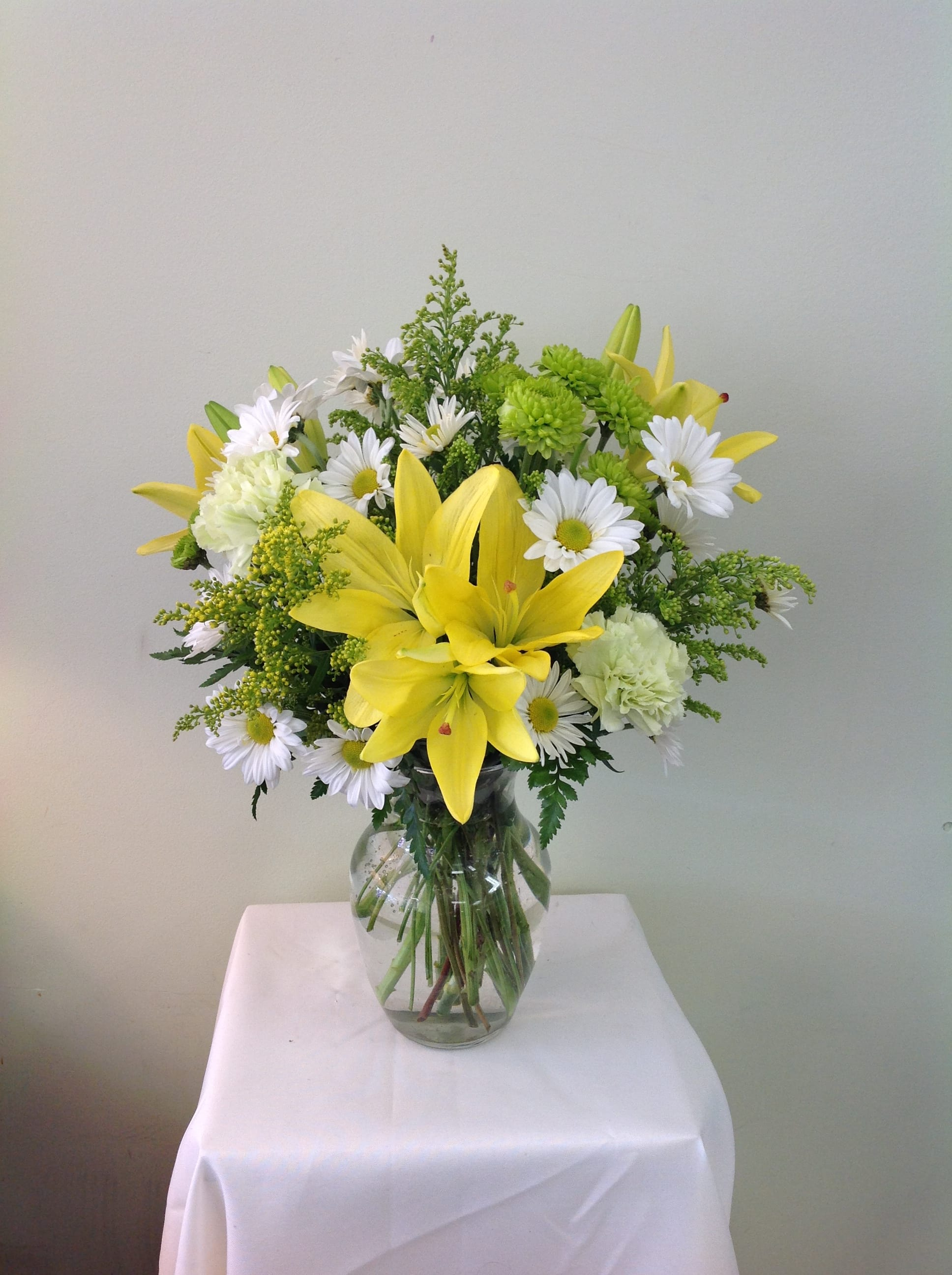 Sweet Simple Sunshine - Bright and cheerful mix of yellow and green flowers in a clear