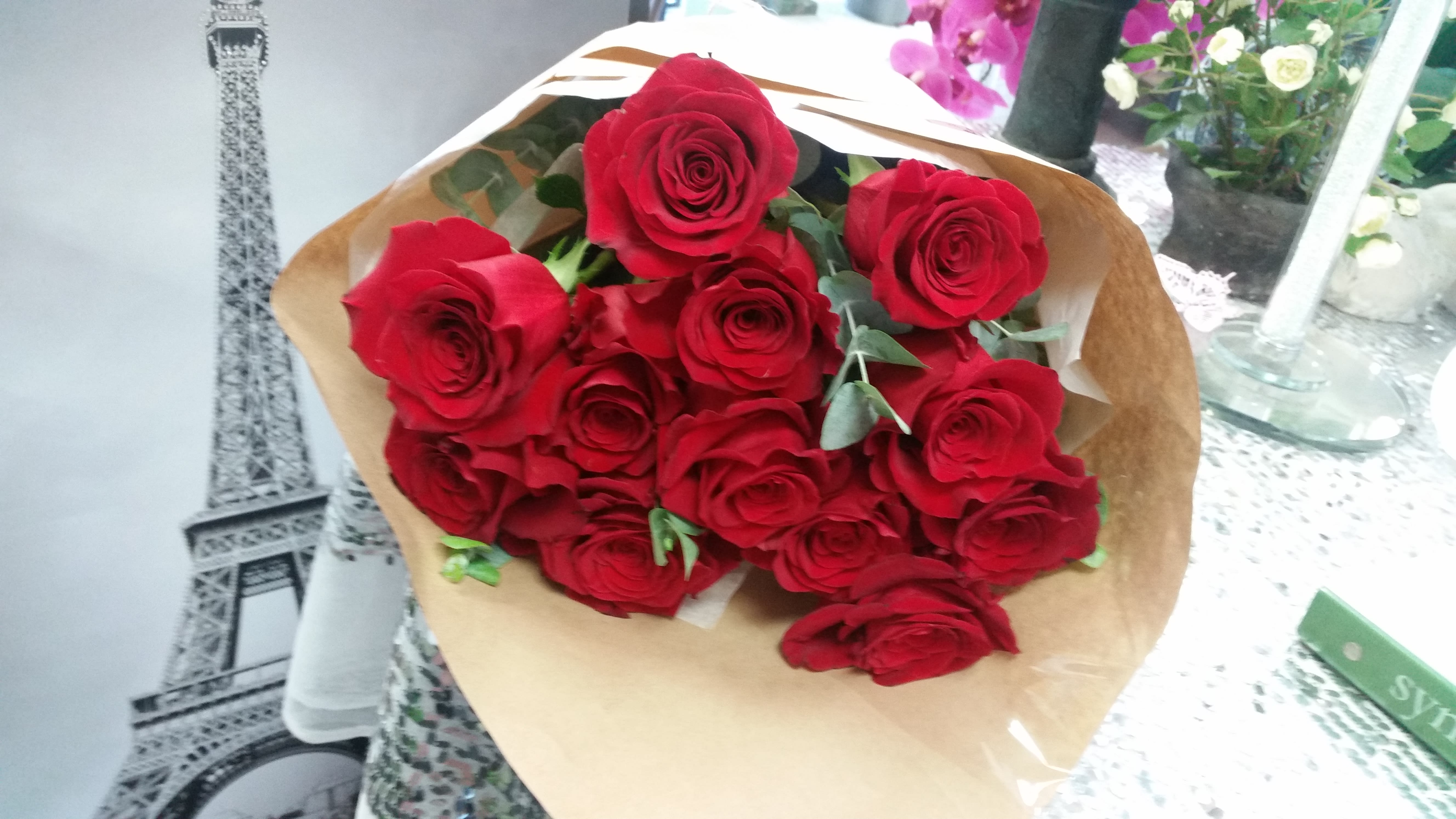 Red Hot Baby Roses Bouquet Wrapped In Brown Paper In Cerritos Ca