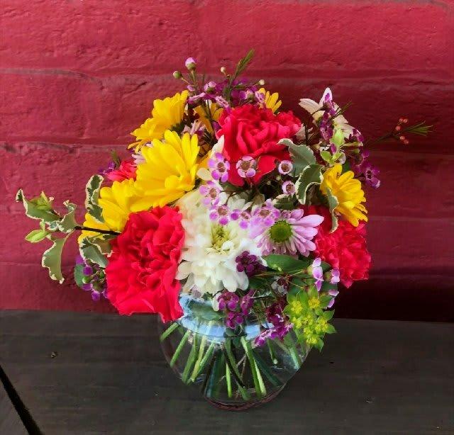 Ginger Jar - This petite floral arrangement is a sure fire pick me up, that