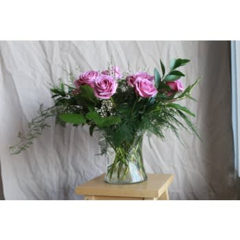 b642989e0f2 Diana. A large and deluxe garden-style dozen rose arrangement for your  loved one.