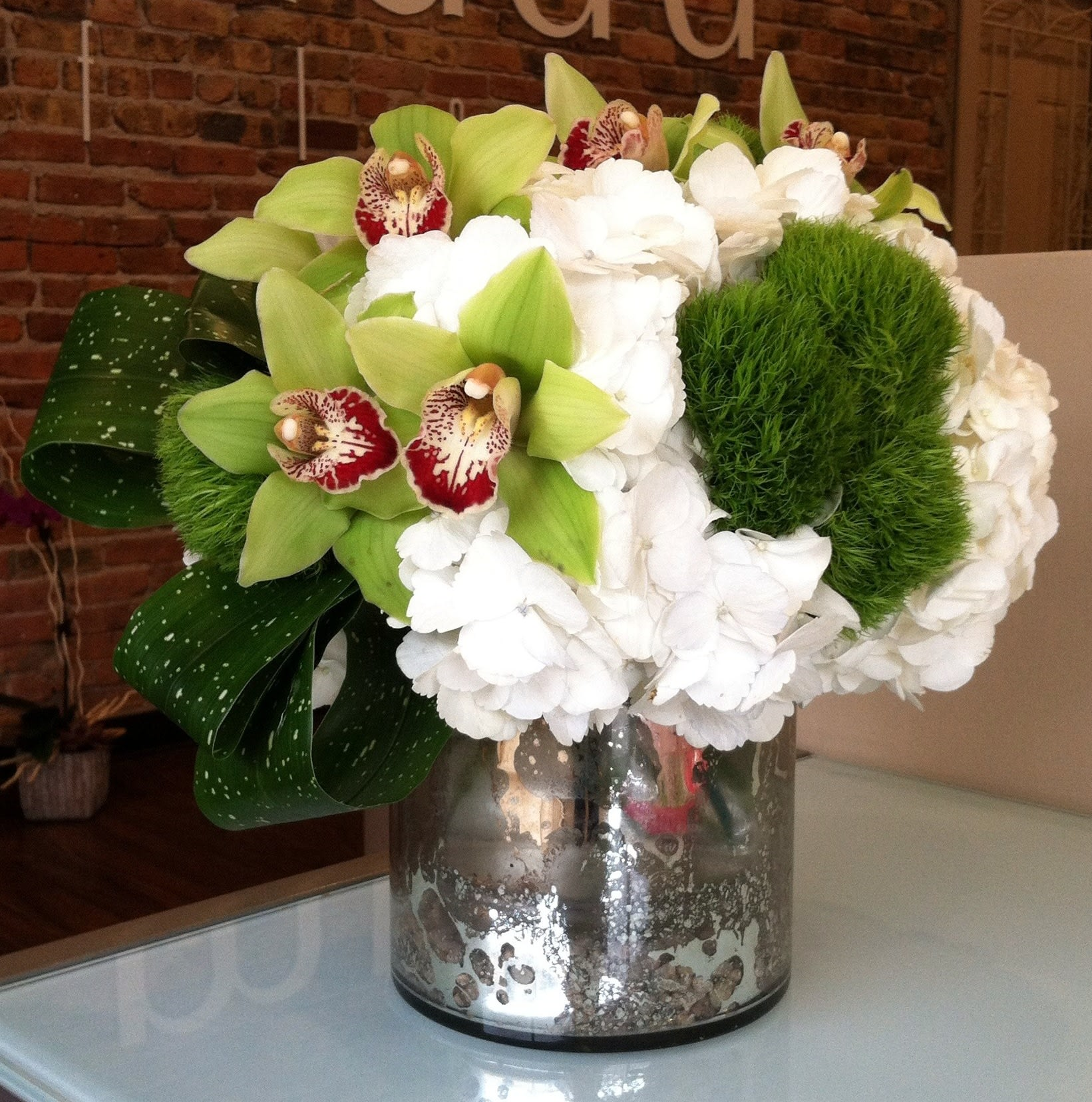 Green Cymbidiums and Dianthus