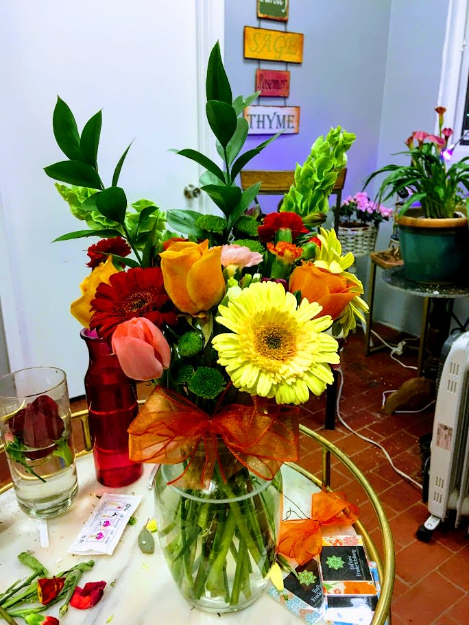 Fresh flowers arranged in a vase with a variety of flowers that