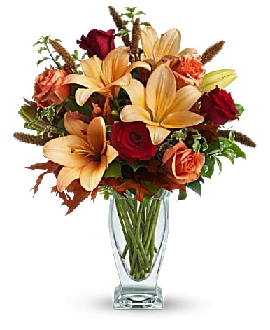 Fall Fantasia - Roses, lilies and oak leaves create a fantasy of fall flowers.