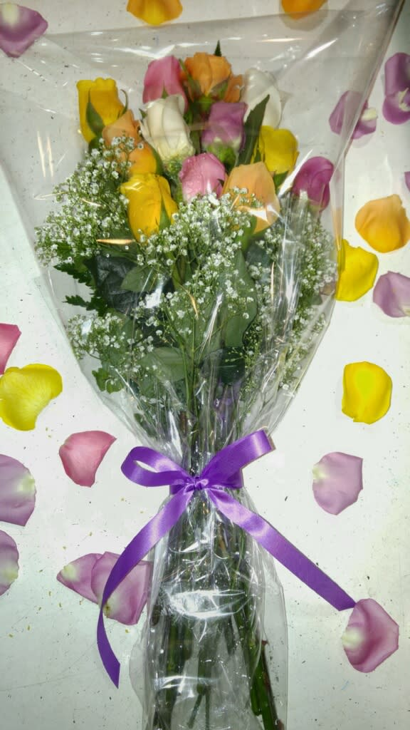 Dozen Pastel Roses Gift Wrapped - Send the most classic flower gift yet. Twelve perfect