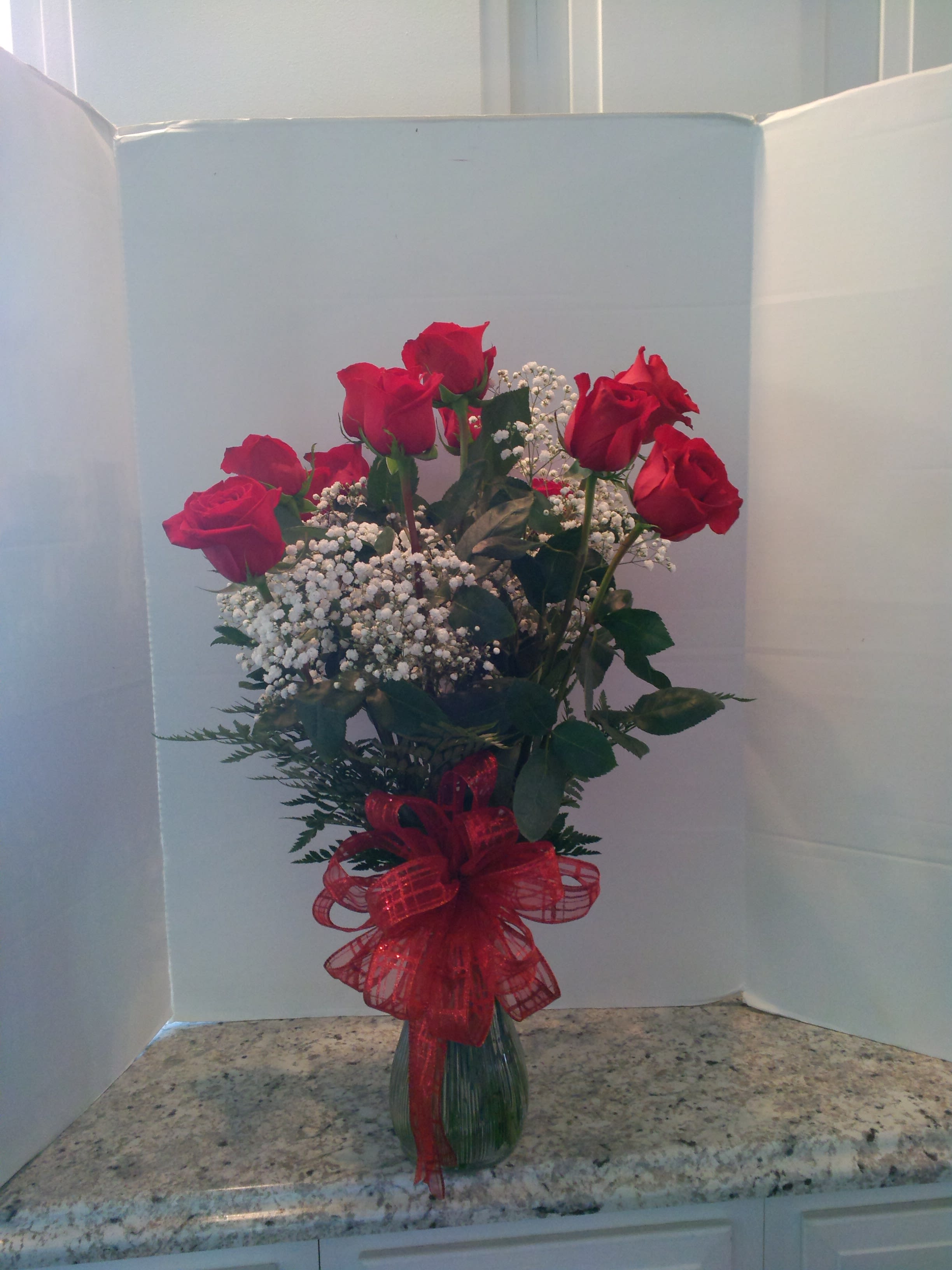 Dozen Red Roses Beautifully Arrainged In A Glass Vase In Fulton Ny